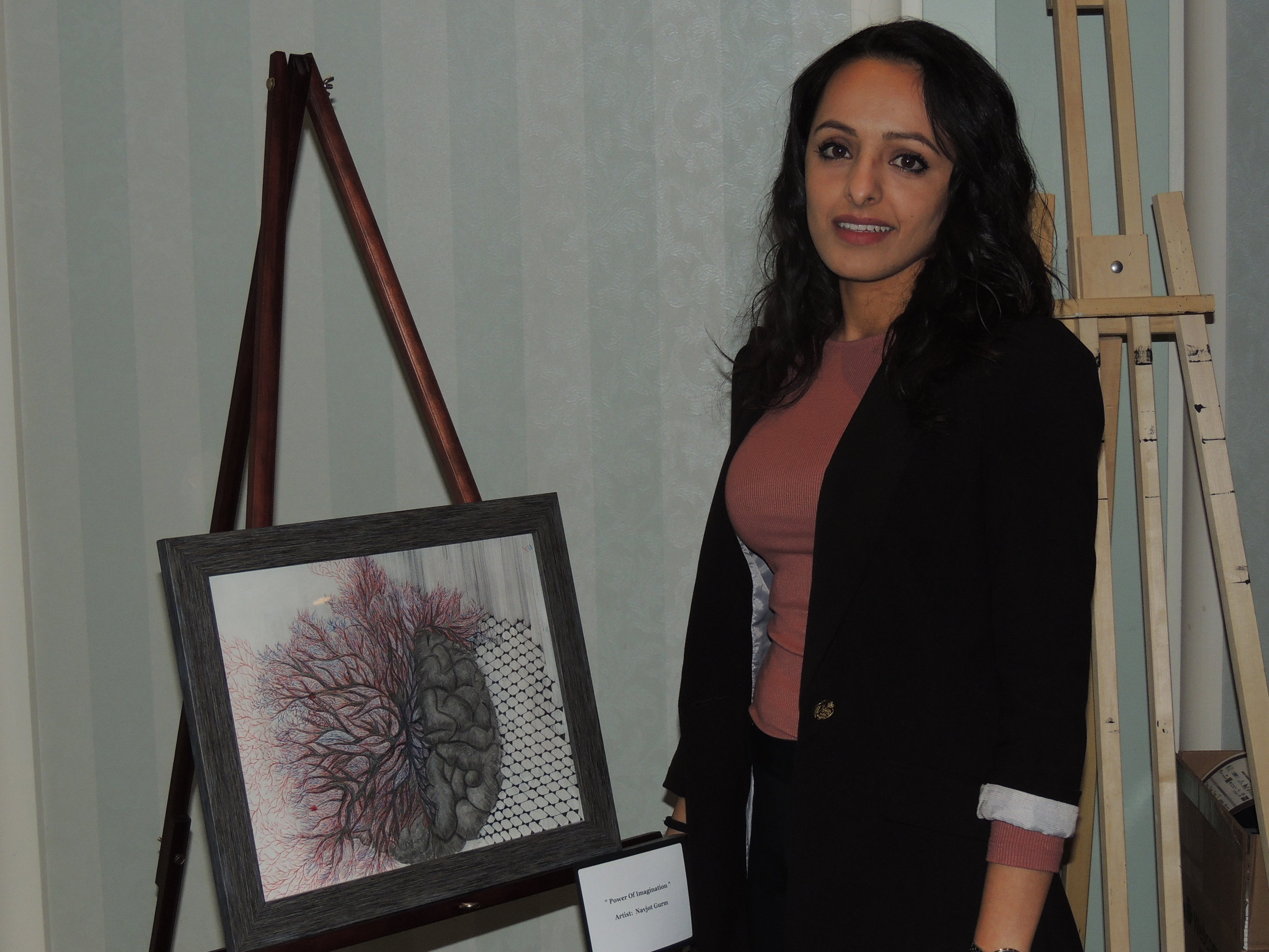 The Artis 3  Featurette artist and ABI & mental health advocate Navjot Gurm & some of her artwork. Photo by Mira Louis.