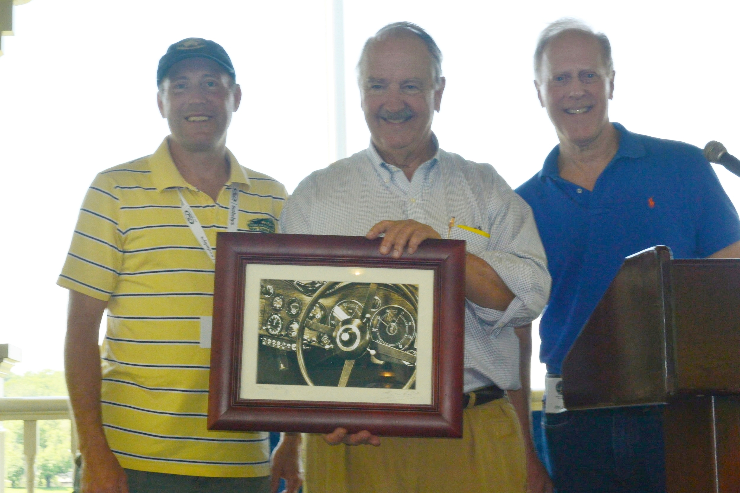 Steve Brauer accepting a gift of gratitude from the UMR and Spirit Regions. Alongside are Webster Peterson (l), organizer of the Nordic CARavan, and John Lowell (r), Spirit Region Director.