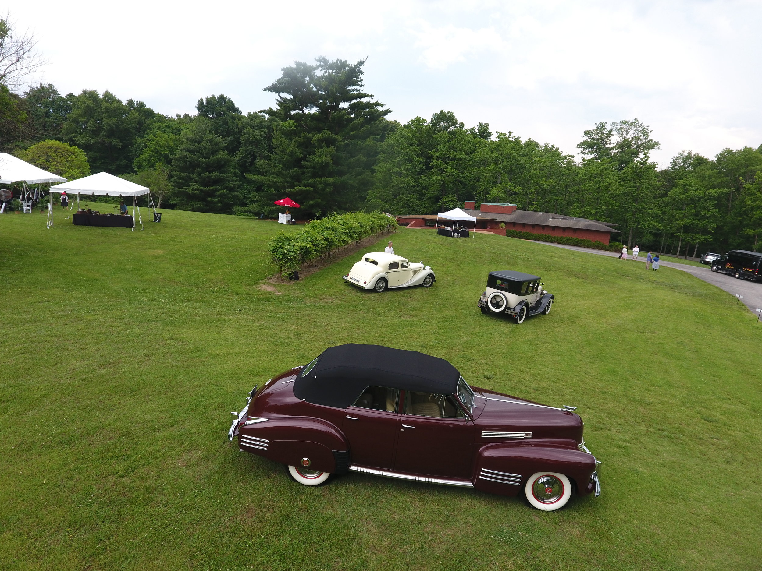 The grounds rolling hillside makes for a perfect setting for a trio of magnificent Classics