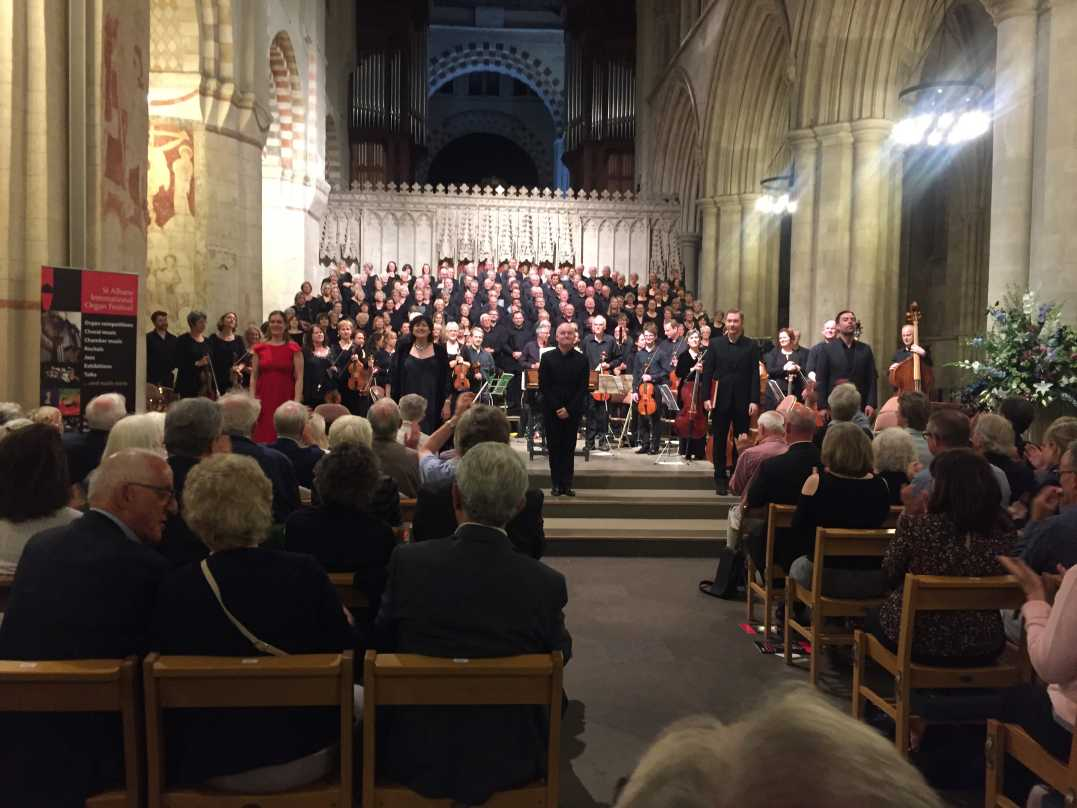 Conductor, soloists, orchestra and choir acknowledge raturous applause.