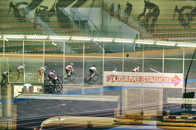To give you a small insight into my brain: I love this shot, as it's a picture of a reflection of track cyclists on a window going out of the track stadium against the wall of a shopping center that has cyclists on its facade and a sign that leads to the entrance of the track stadium... 😬🤯