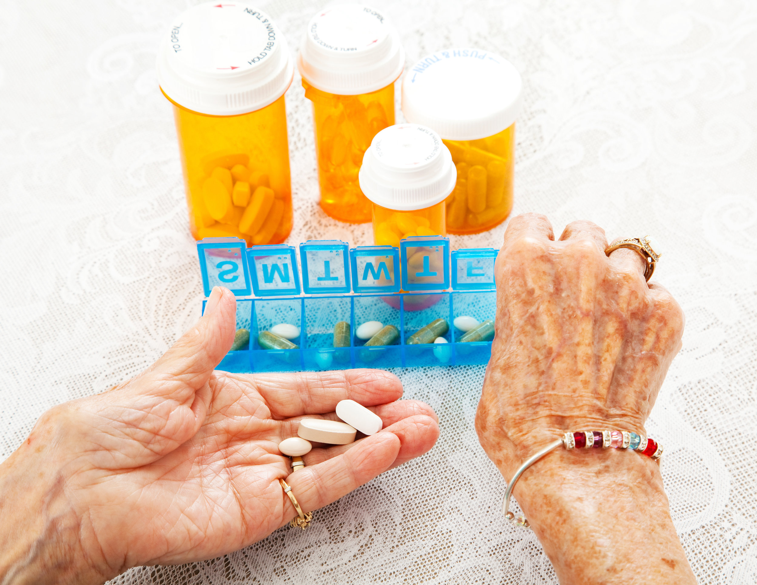 Senior woman and medications