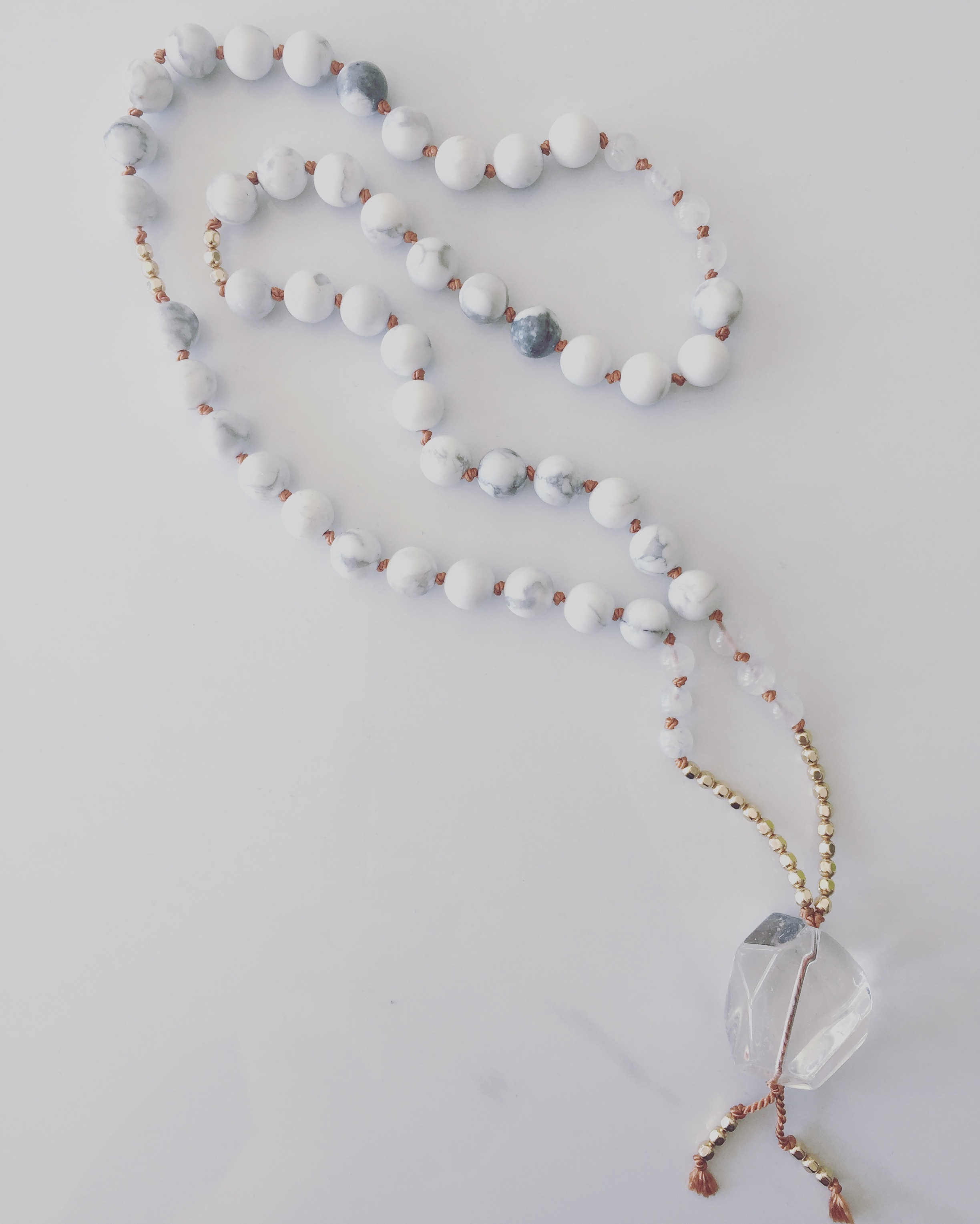 FEATURED MALADivine Feminine Mala - Your divine feminine is being asked to be loved and embraced. Howlite is the stone of the divine and collective conscious energy and tunes directly in with the mind. When you allow for peace and tranquility to be present in the logical mind, you truly hear what your intuition is saying. Moonstone supports you in using your five senses to guide your attention inward and connect with your intuitive wisdom. Just as the moon sheds light on the deep mysterious ocean waters, the guiding light of the divine feminine guides you to be in introspection. This gives you space to balance male / female and emotional / intellectual energies within.STONES | moonstone, howlite, and clear crystal quartzMANTRA | I am a wise, sovereign queen who knows when to discern logic from intuition.SHOP NOW >