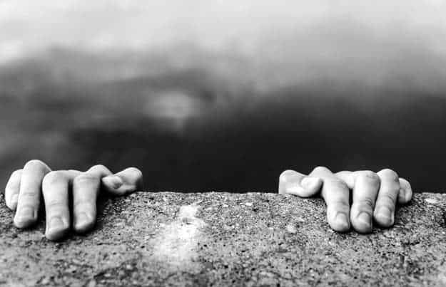 holding-on-edge-cliff-how-spirituality-may-help-depression-ss.jpg