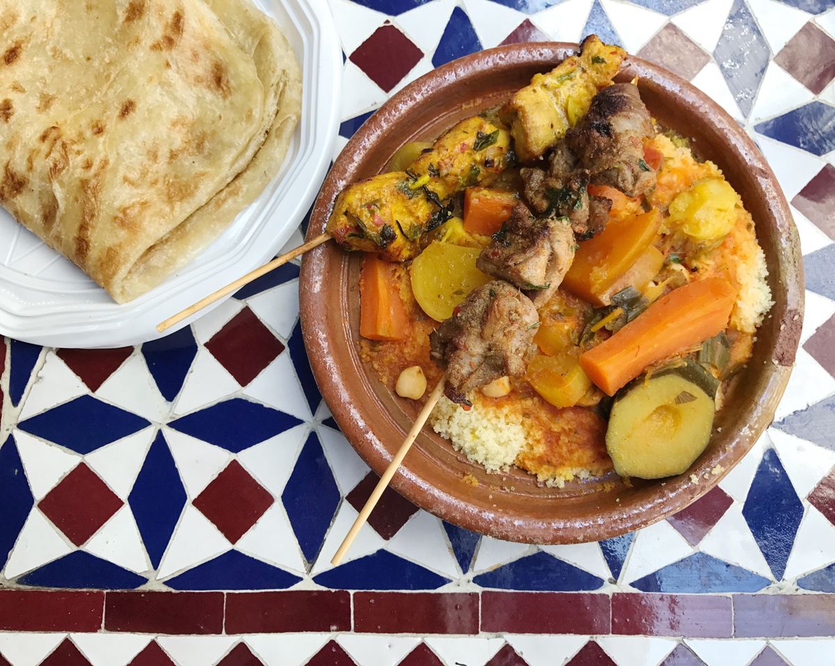 Outstanding Moroccan food - this is chicken and lamb over couscous.