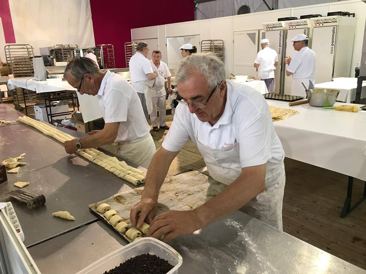 Bakers making petite pain au chocolat (mini chocolate crossaints)