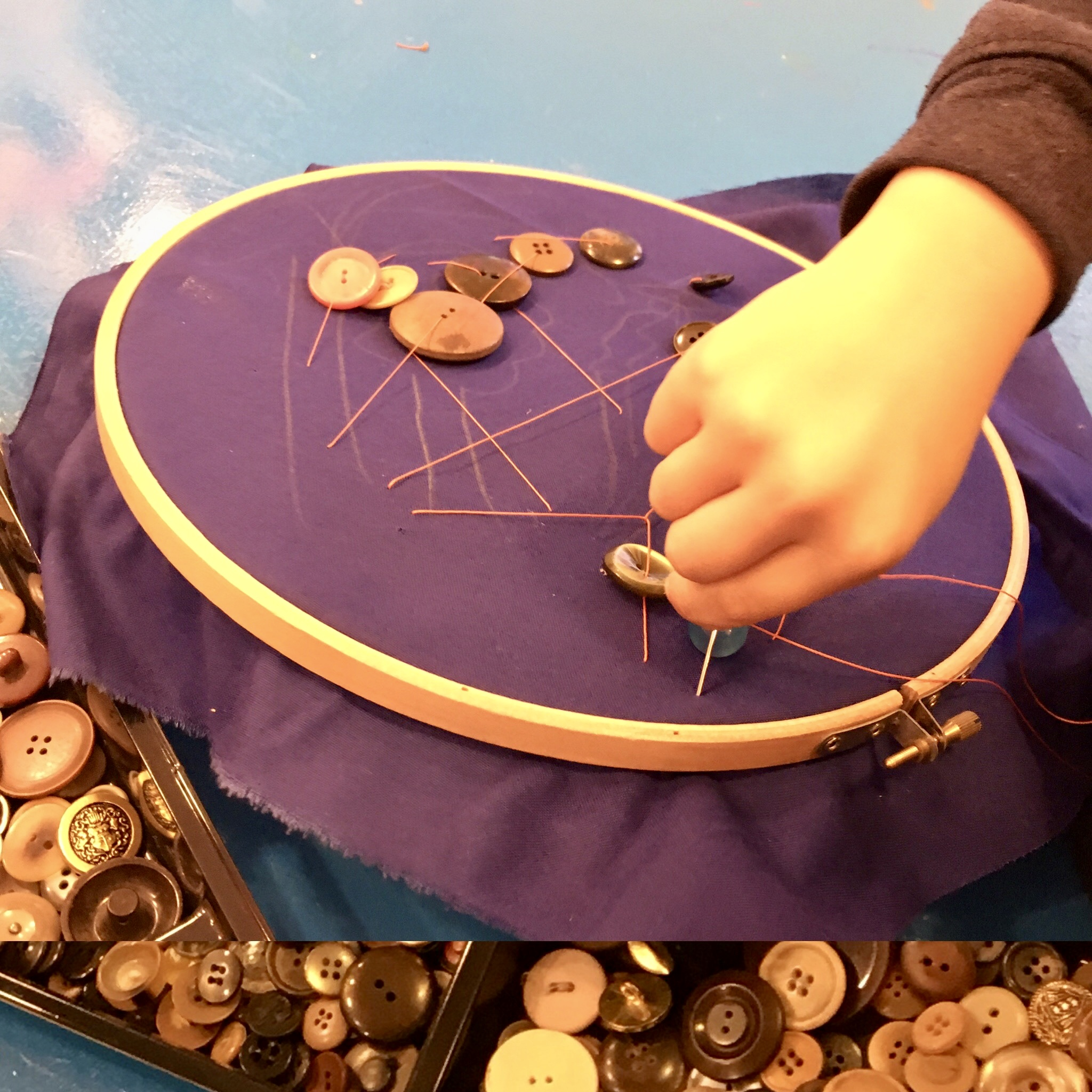 Play & Explore - Sewing - Using embroidery hoops and orange thread we chose buttons and beads to add to our dark blue cotton drill background. 5 year olds always get such satisfaction from sewing, and from free choice.