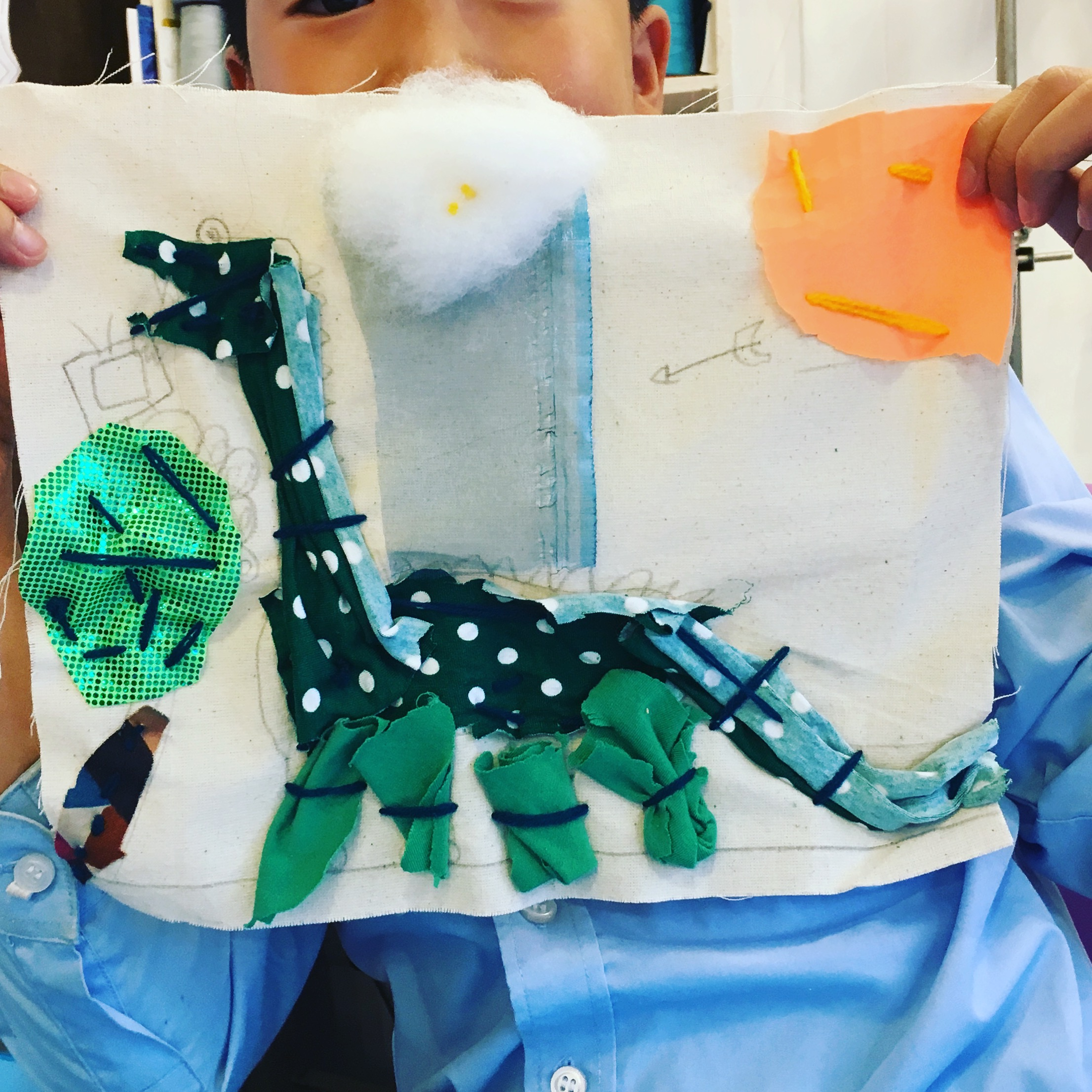 Discover & Create - Applique - With a wide selection of fabrics and wool these makers cut and stitched their own design onto heavy cotton drill. D. was really happy with his dinosaur -