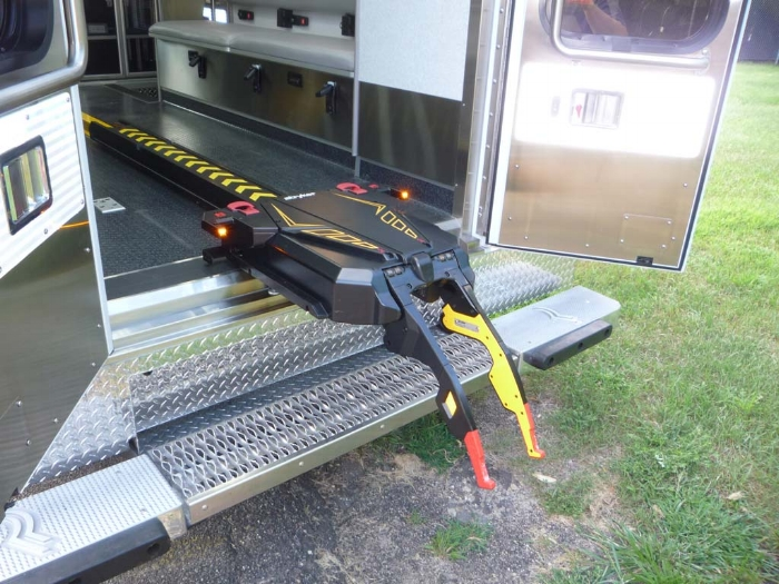 """Prior to this innovation of this """"power load"""" and retention system there had been no change in the way cots are mounted inside ambulances (in the US) since the 1970s."""