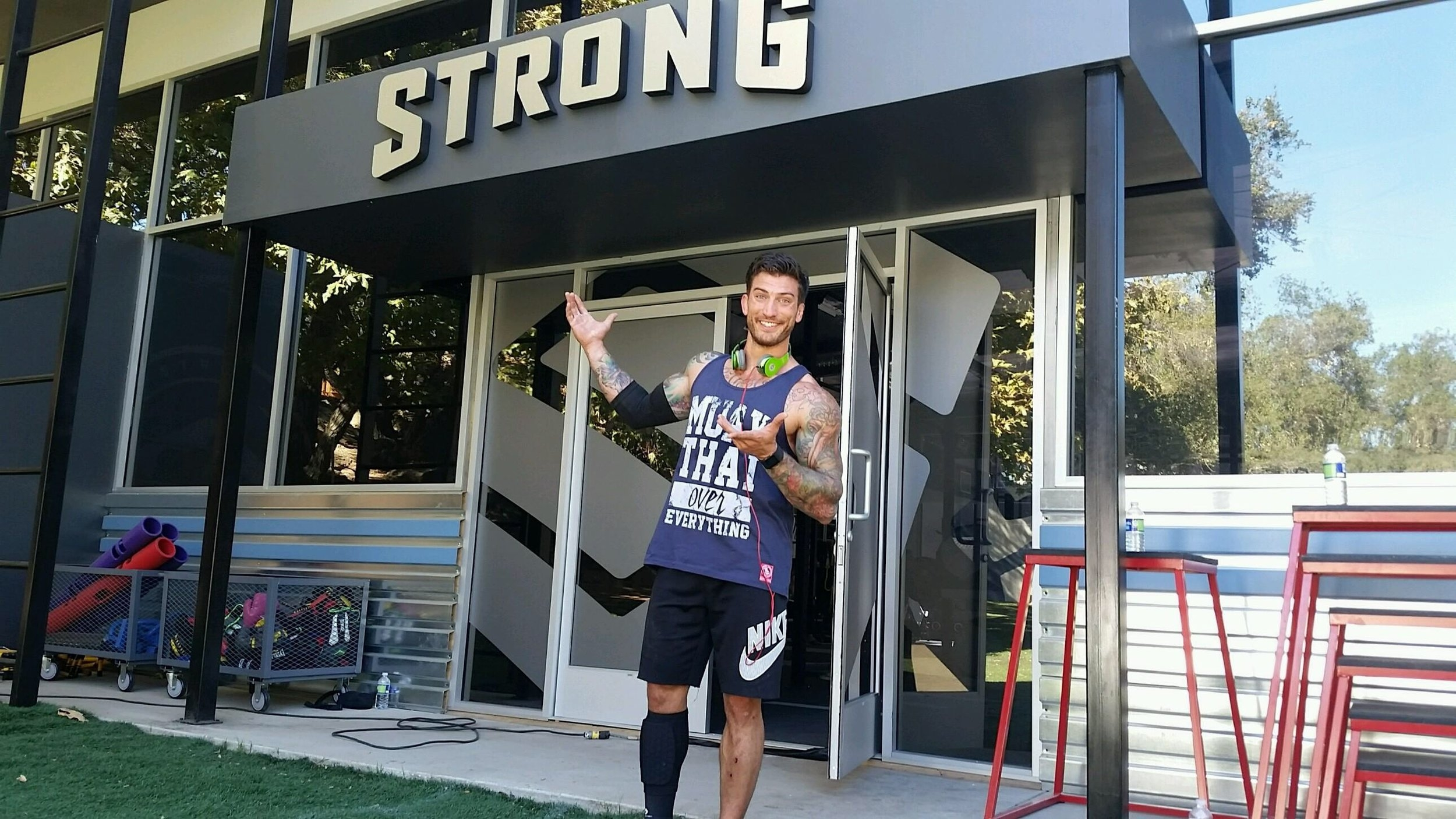 Adam on set of reality TV show, NBC's STRONG...