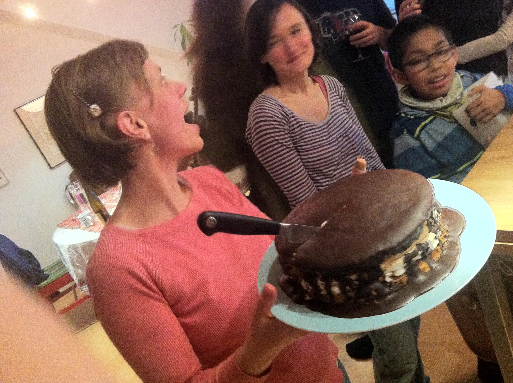 Lavish Chocolate Meringue Cake, in the process of celebratory dismemberment