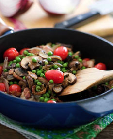 Mushrooms with peas and tomatoes is the perfect side dish paired with roasted pork or chicken.