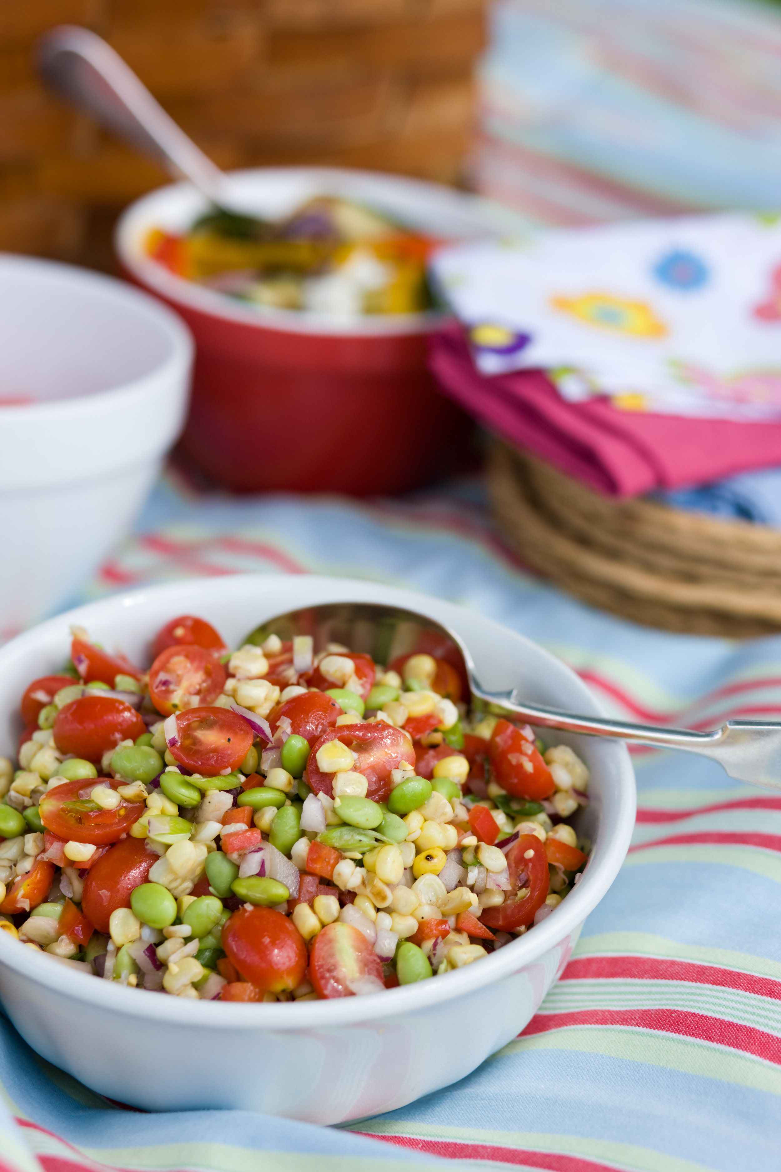 Succotash made with edamame, corn, lime, red onion, tomato, bell pepper and green onion.