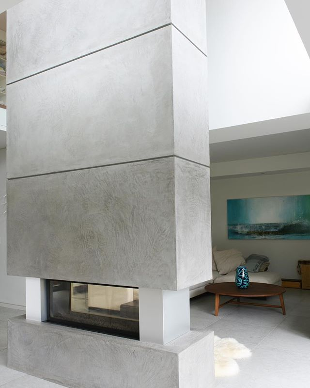 Our Matt Concrete Panels create a striking two-story fireplace surround. #artsandlabour #mattconcrete #meetmatt  Photo: @tracey_ayton • • • • • • • #concrete #concreteoverlay #concretelove  #interiordesign #design #architecture #renovation #newbuild #contractor #artisan #handcrafted #luxury #luxuryhomes #dreamhome #housegoals