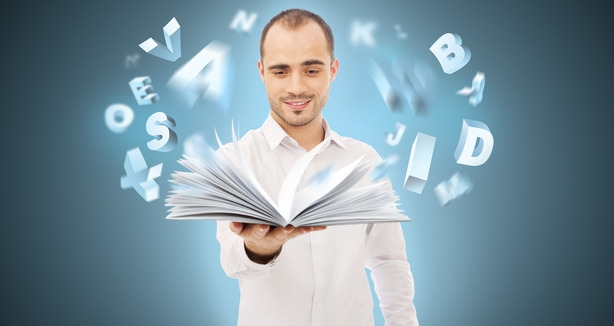 photodune-4800333-adult-man-holding-an-opened-book-and-reading-letters-are-flying-xs.jpg