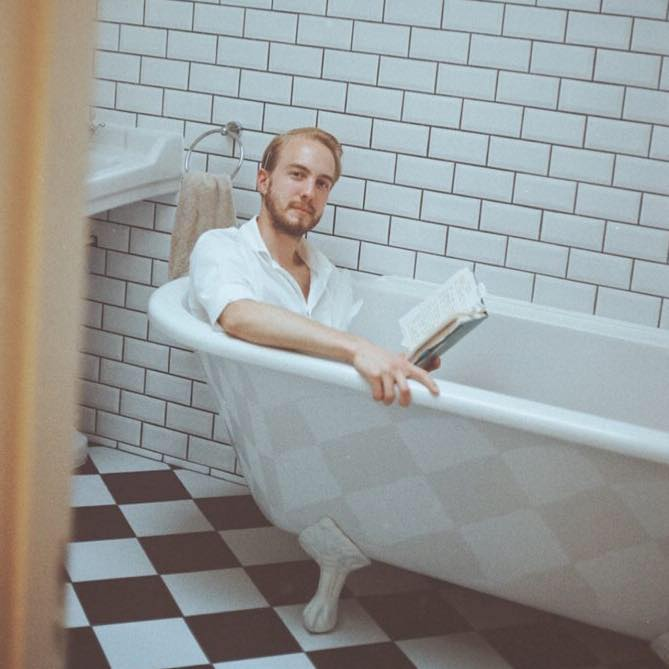 Poetry in the bathtub at La Nuit De L'Art, Colombia Road, London.