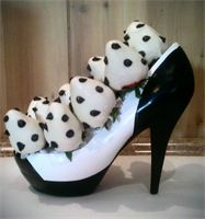 Shoe-La_La      $44.99 : 1 doz chocolate covered strawberries nested in a high-heeled porcelain pump.
