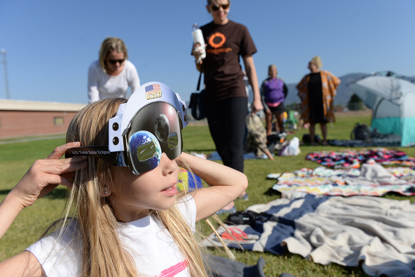 Olivia loved watching the solar eclipse, and the cool eclipse glasses didn't hurt either.