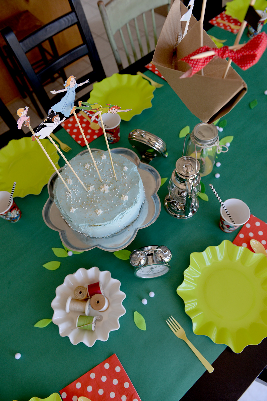"""Lanterns, tick-tock-clocks, thread for sewing on shadows, and a """"kiss"""" (thimble) for our Neverland party table."""