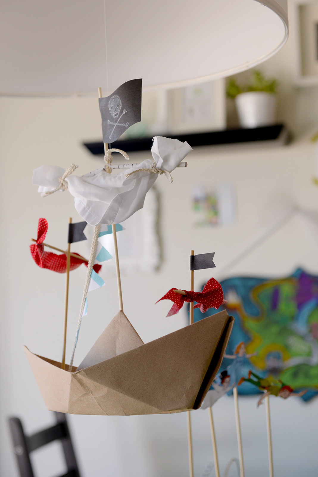 Every Neverland party needs a flying ship! (Even if it is made of paper, wooden skewers, and scraps of fabric.)