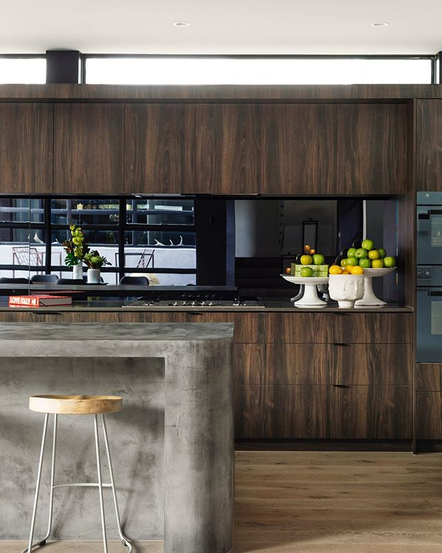 We love mixing different materials together in all our projects. In the kitchen of #J101 we have used @altsurfaces X-Bond Microcement with timber floors, joinery and a reflective tinted mirror to open up the space #acgmelbourne