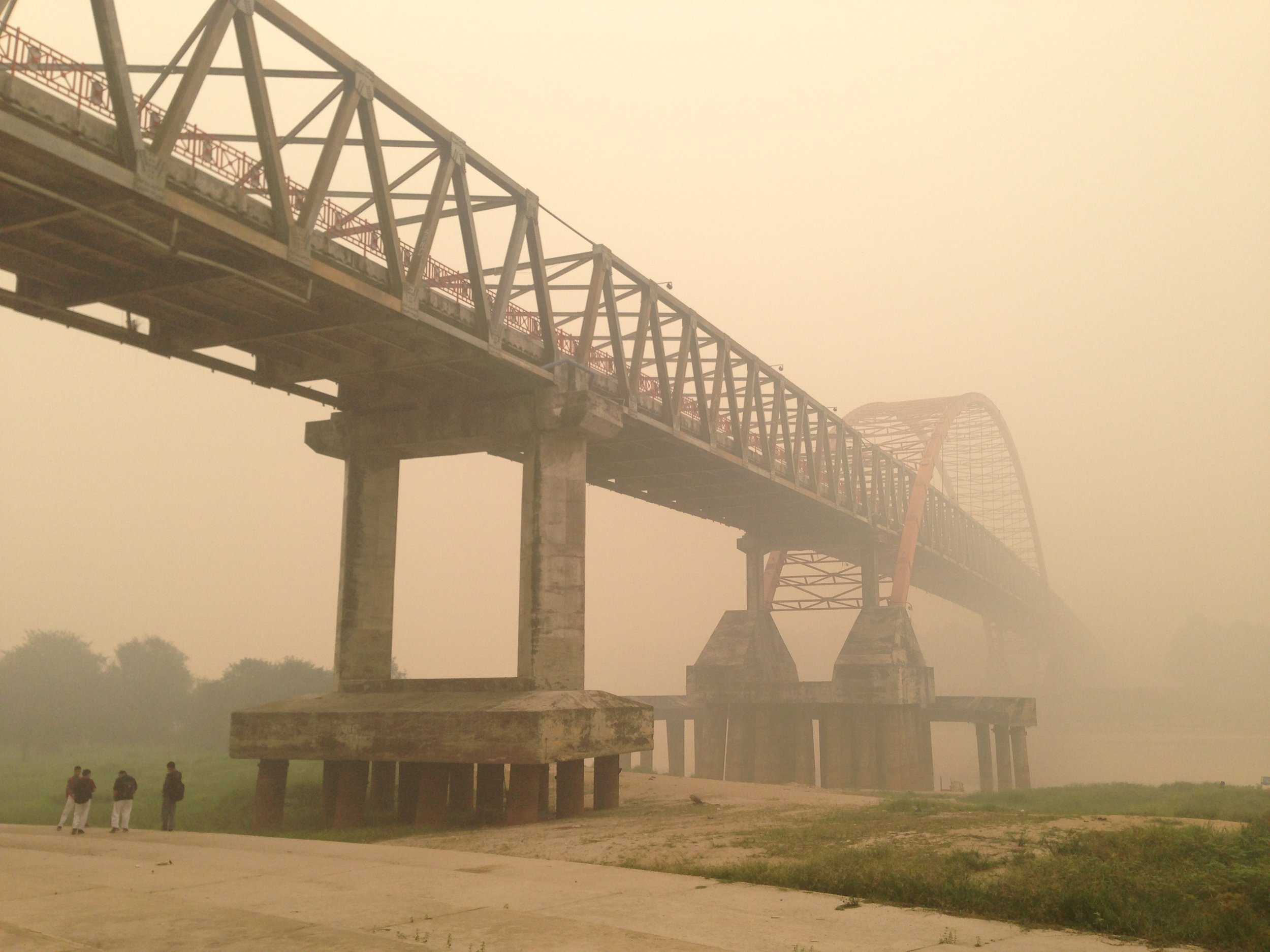 """Photo of Kahayan bridge in Palangka Raya during the peak of the fires in September 2015. This """"haze"""" filled the air for months, causing widespread sickness, slow crop growth, and closed businesses and schools.  Photo by GAMBUT staff Sherry Panggabean."""