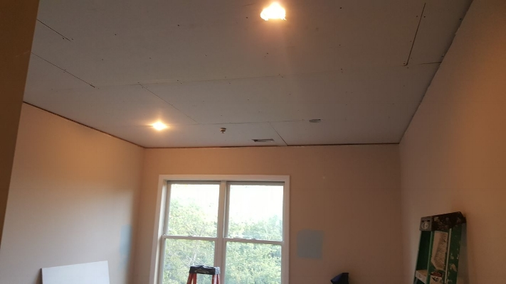 Finished bedroom ceiling after soundproofing and recessed lighting installation