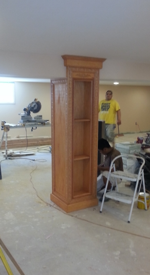 Custom wood work on basement column stained