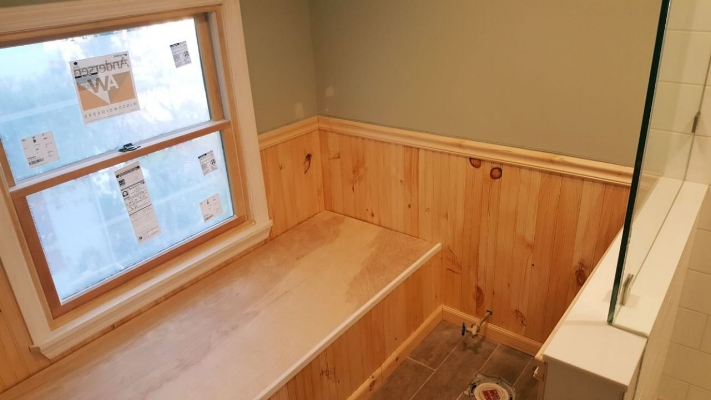 Custom bench in bathroom to cover HVAC duct work