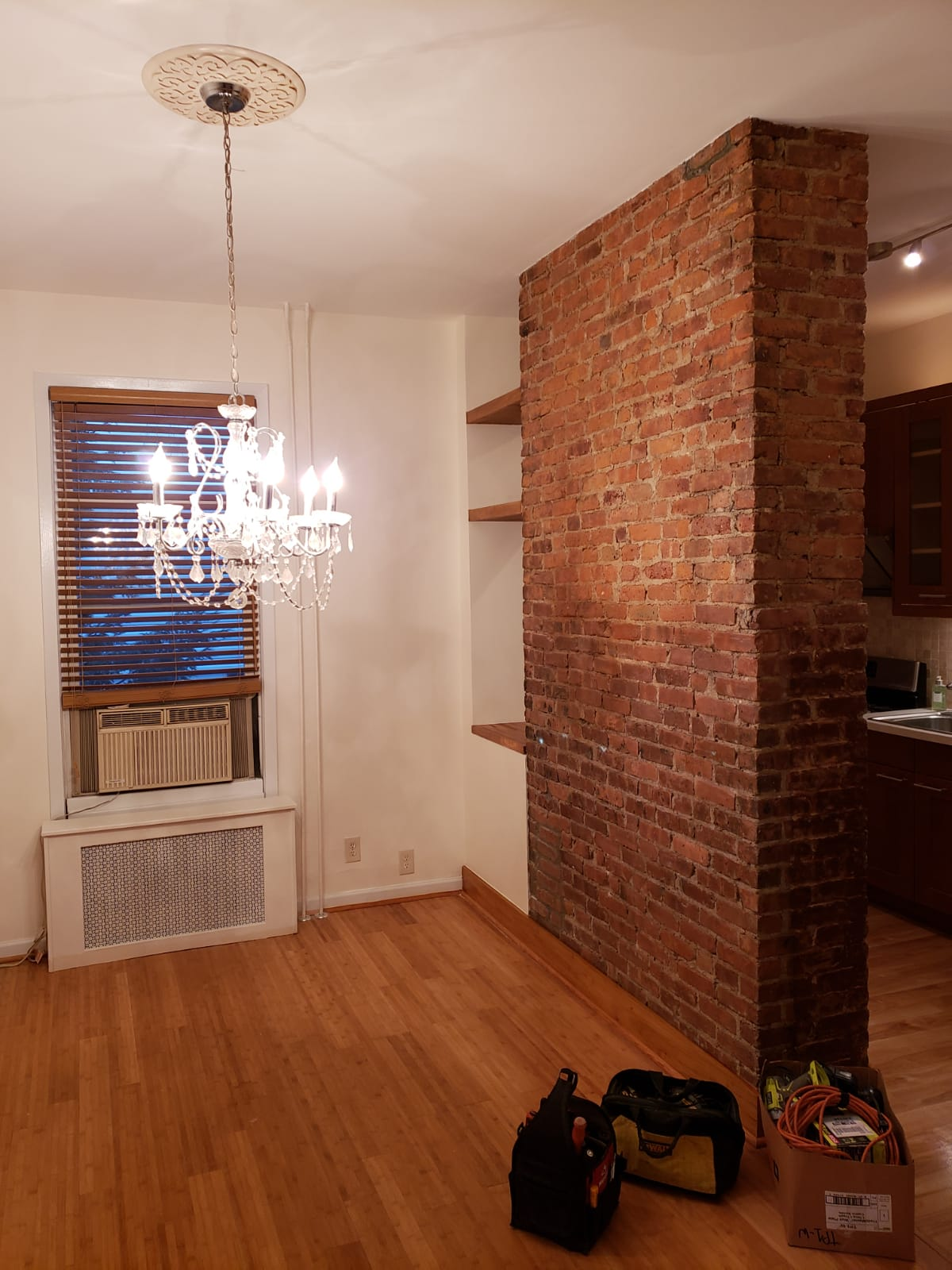 Custom trim work and moulding with newly refinished brick wall
