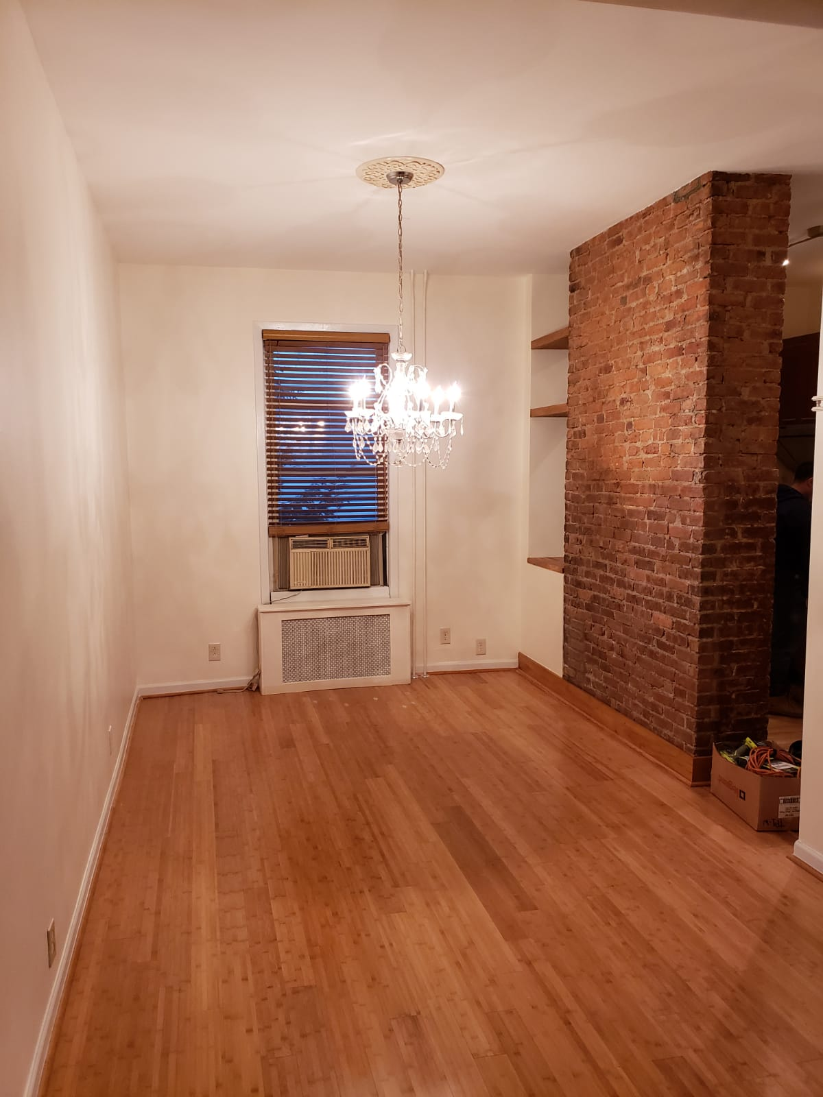 Custom floating shelves, trim work and moulding with newly refinished brick wall