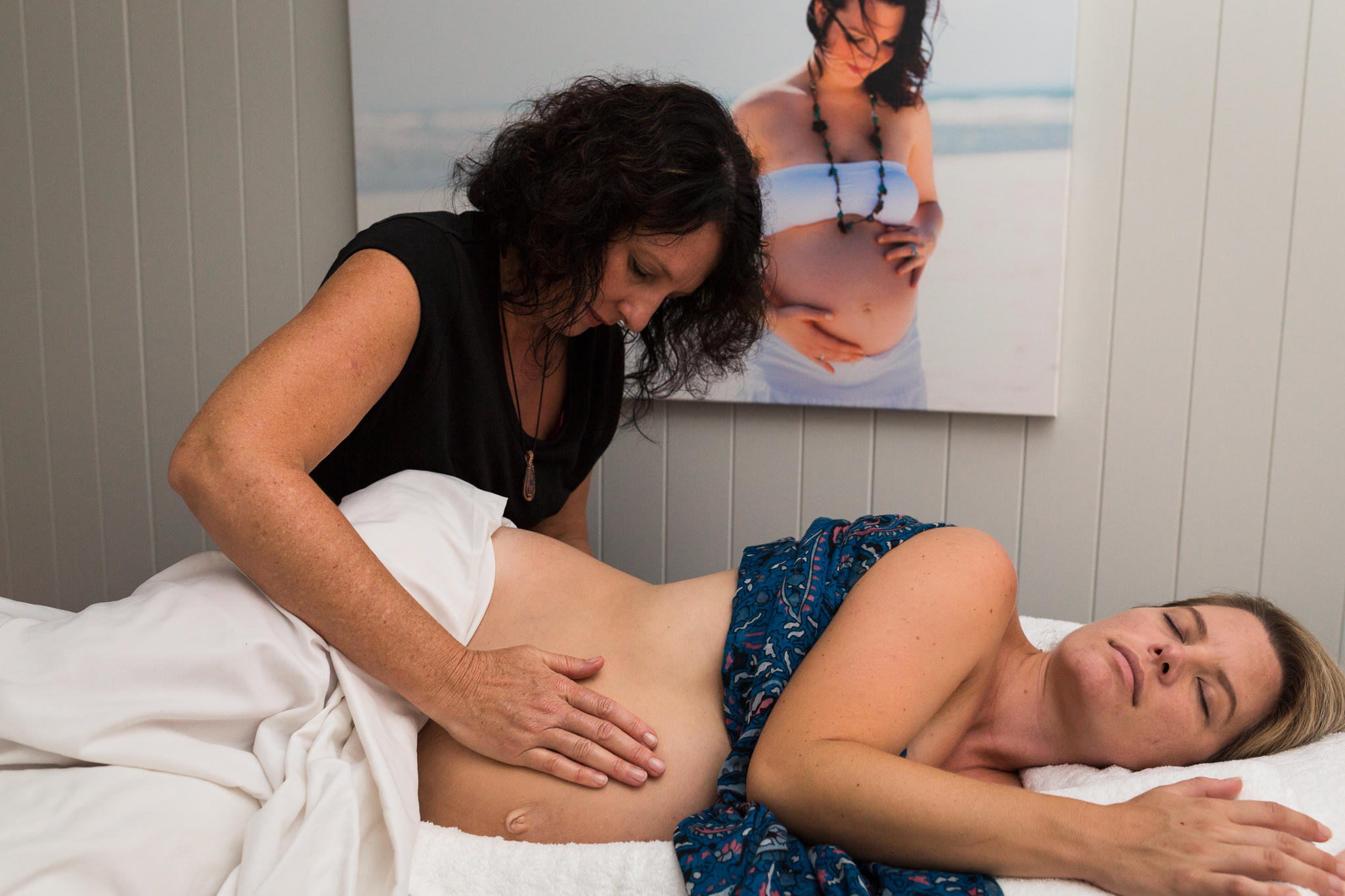 Michelle massaging a pregnant mum