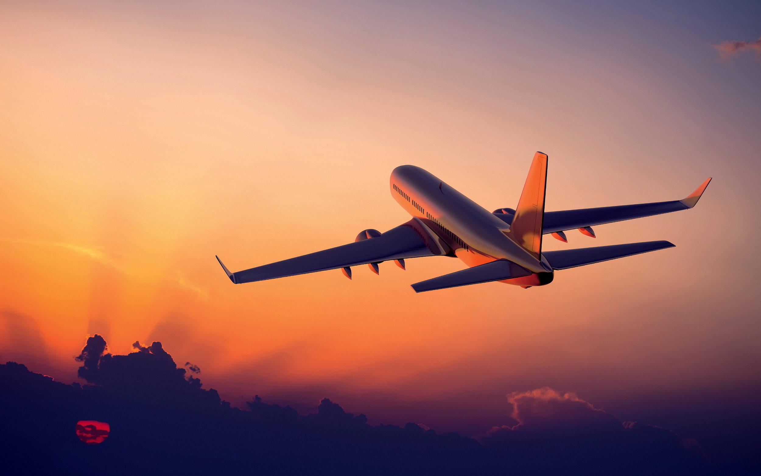 7014902-airplane-flight-sunset.jpg