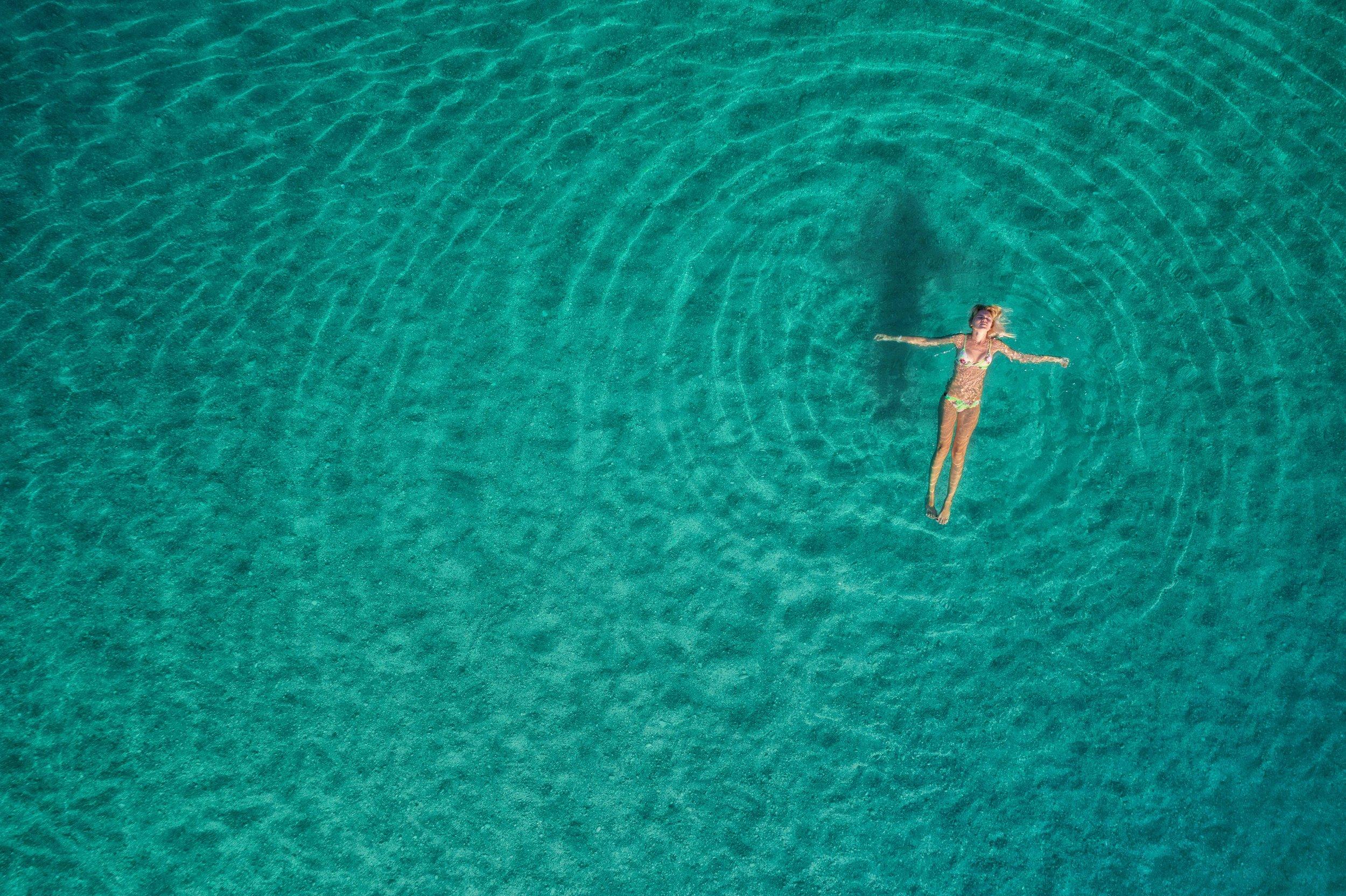 aerial-view-of-swimming-woman-in-mediterranean-PBK6ZLG.jpg