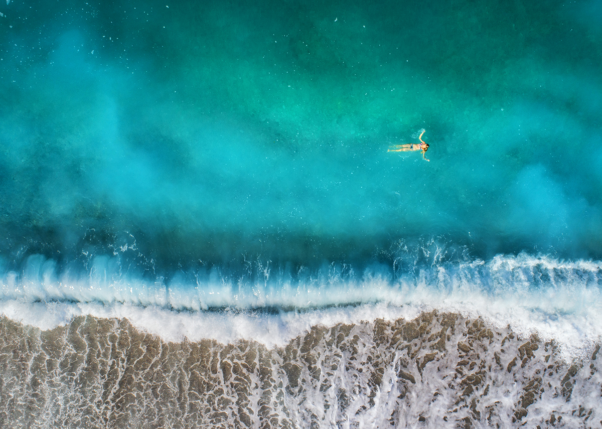 aerial-view-of-swimming-woman-in-mediterranean-THS.jpg