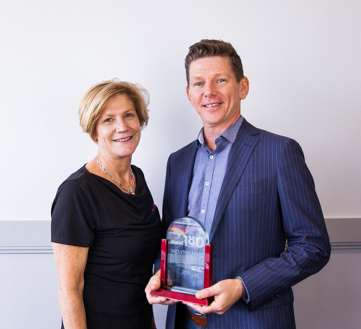 Marist 180 CEO Cate Sydes and Steve with the Innovation Award.