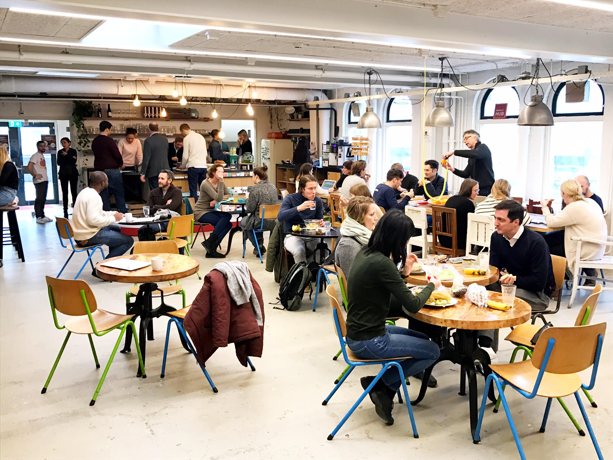 The bustling cafe at Impact Hub Amsterdam.