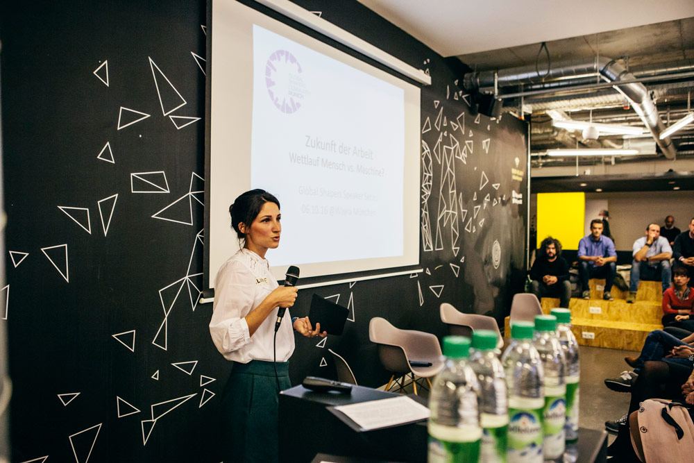 Aline moderating an event organised with the Global Shapers in Munich on the 'Future of Work'.