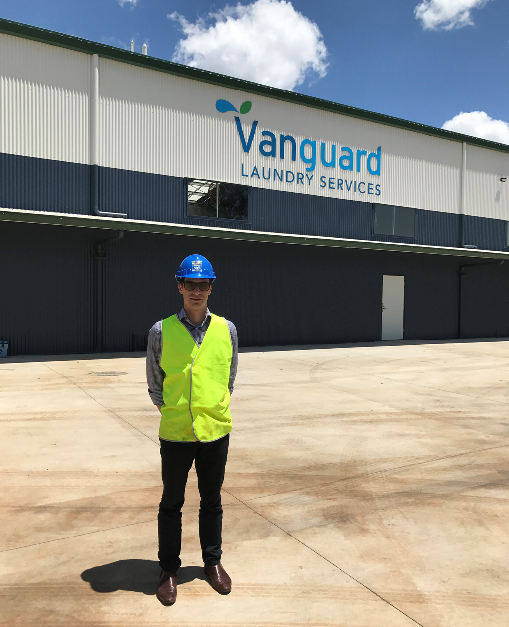 Alex Oppes outside Vanguard Laundry.