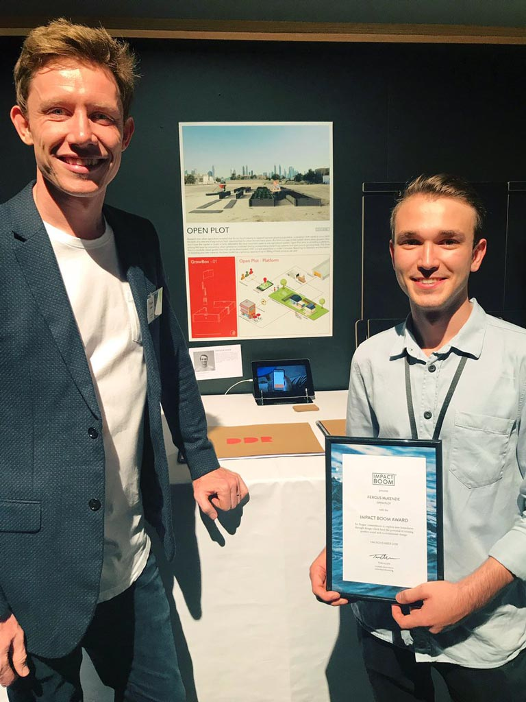 Tom Allen and Fergus Mckenzie after being awarded the Impact Boom Award at QUT.