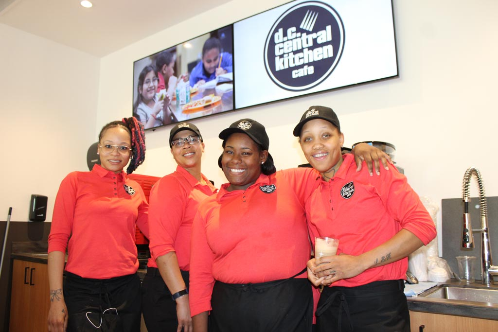 Staff of DC Central Kitchen's new fast casual cafe, which serves healthy, local food prepared by graduates of the Culinary Job Training program, stop for a photo in the front-of-house.