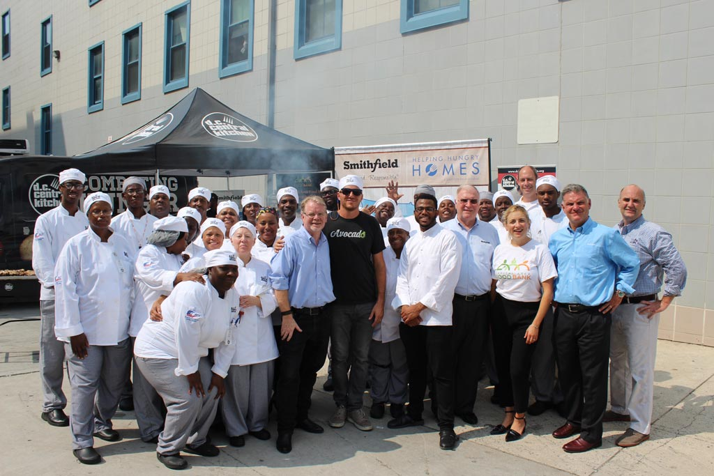 Students from DCCK's Culinary Job Training program join Mike Curtin, Jr. and celebrity chefs Spike Mendelsohn and Kwame Onwuachi for a photo during a donation event with Smithfield Foods.