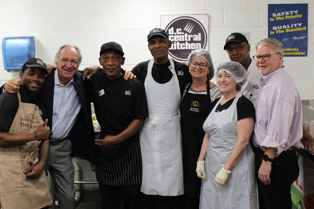 DCCK staff and volunteers pause for a photo during a cooking shift at the organisation's main kitchen production facility in downtown Washington, DC.