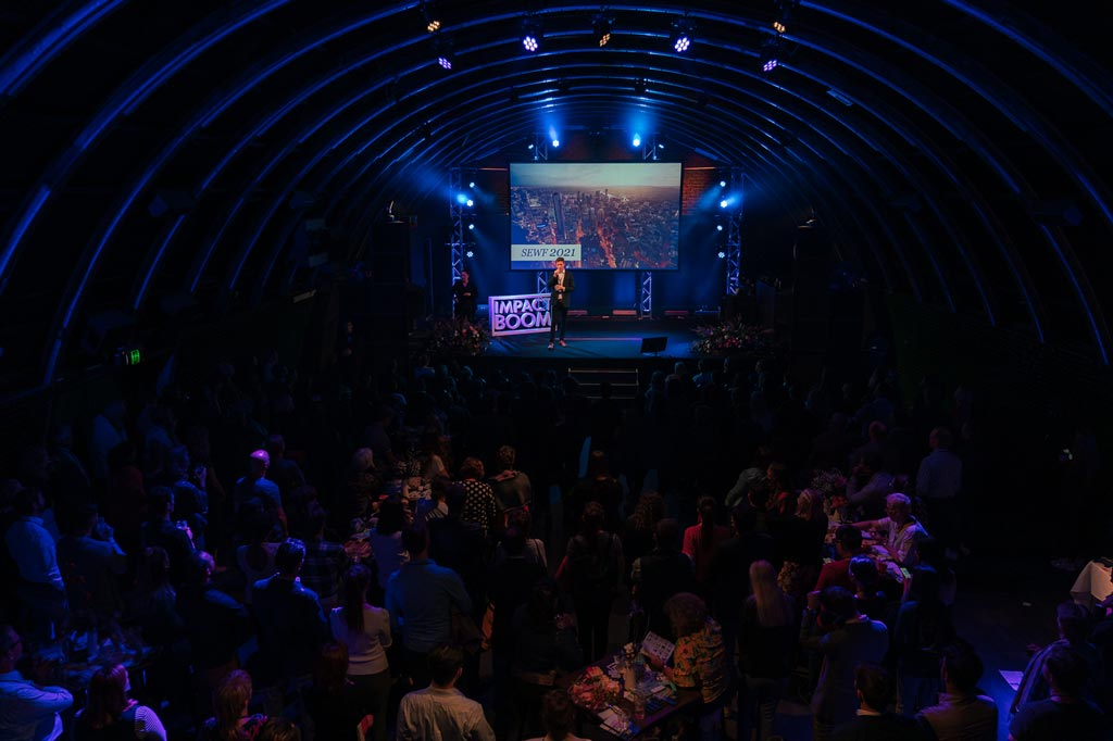Tom Allen presents at a sold-out Elevate+ Showcase event at The Triffid, Brisbane which brought together 300 people from around Australia to celebrate social enterprise.