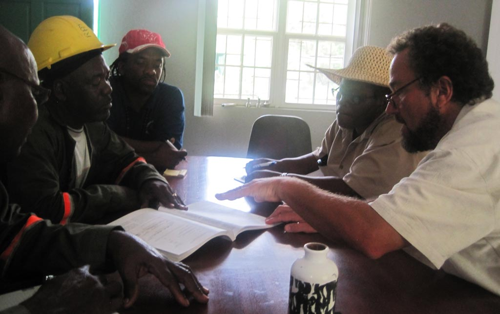Training the landfill operators on the island of Tobago on how to set up a composting system.