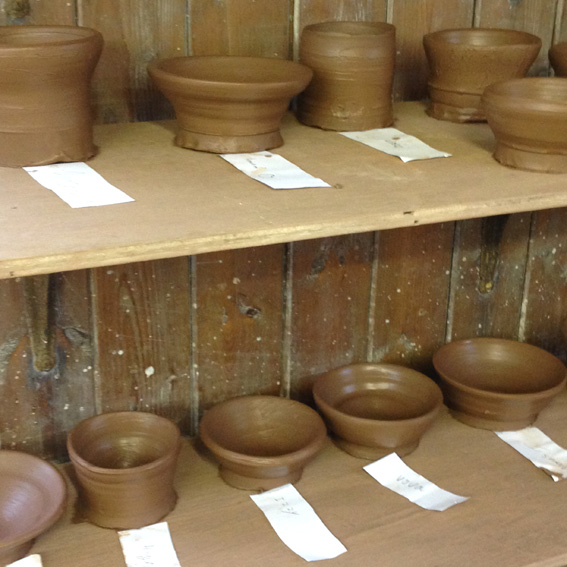 'Have a go - throw'. First-ever bowls, made by children aged 7 - 13.