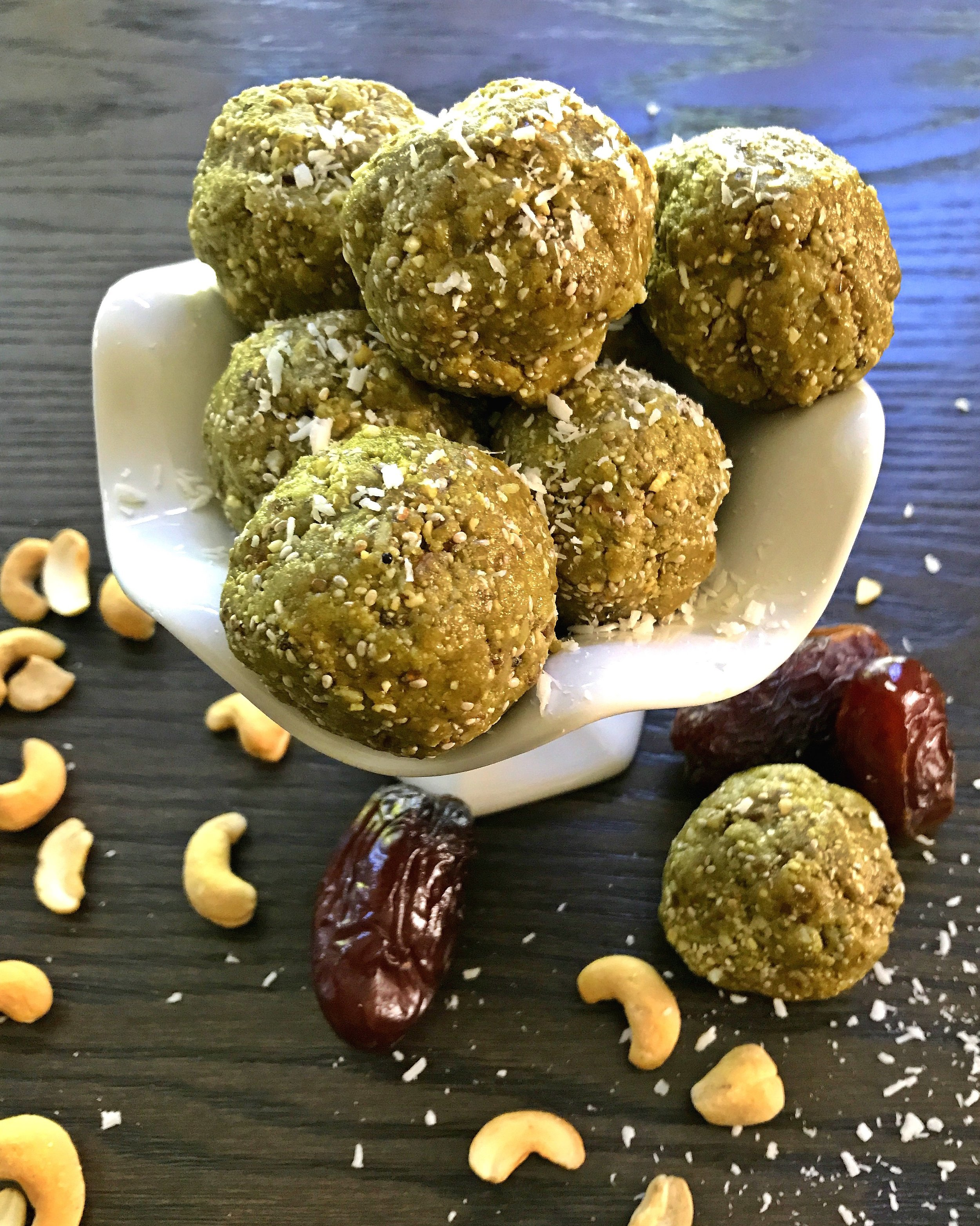 My 3 kids love to test my recipes.  This is a photo of some Matcha Cashew Coconut Protein Balls my eldest made himself.