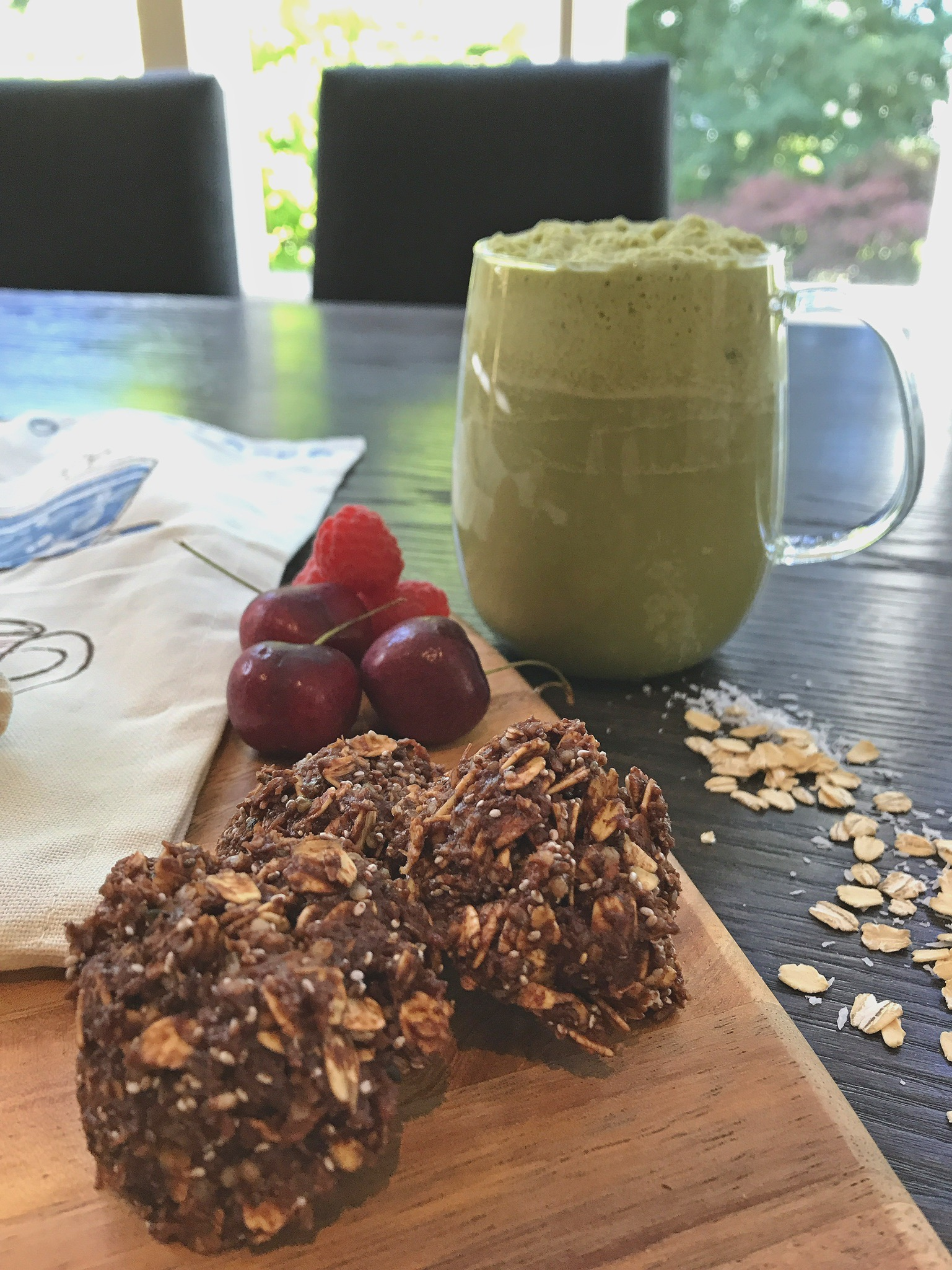 Chocolate Oatmeal Haystacks made with quinoa flakes and served with an iced  loaded matcha latte .