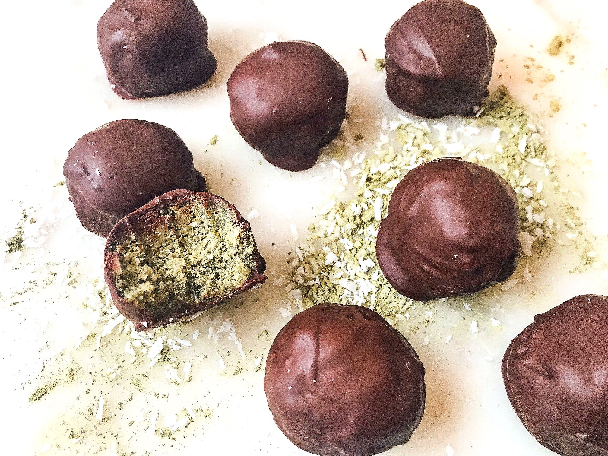 Matcha Coconut Protein Balls made with collagen and coated in vegan chocolate. Photo credit @hostofhealth.
