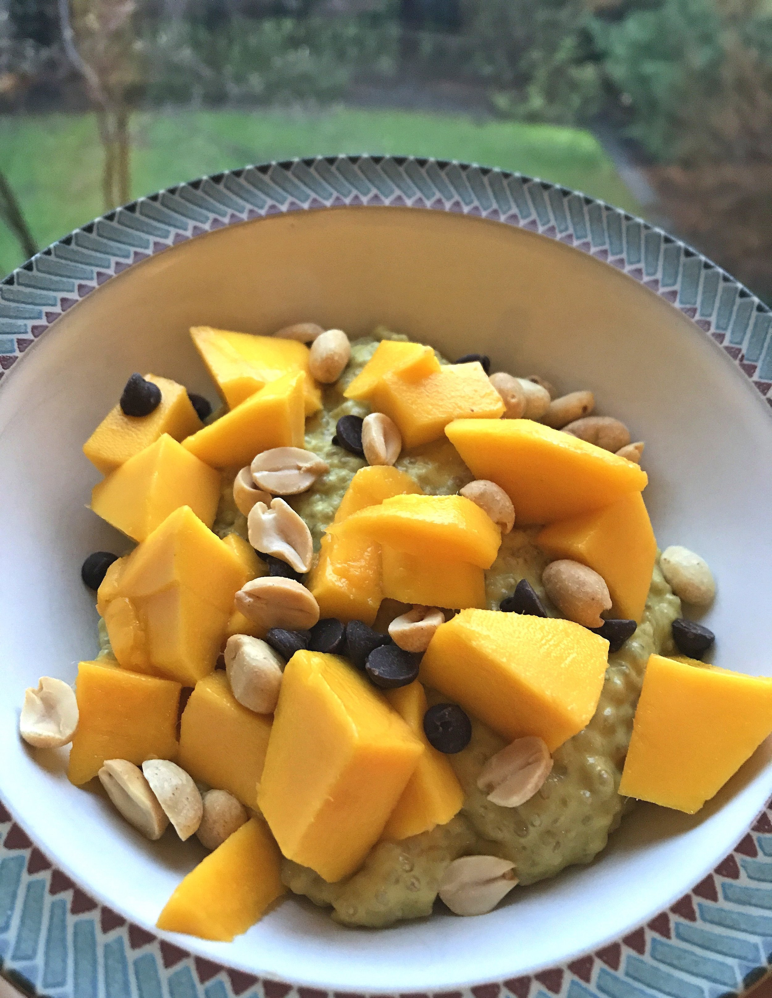 Golden Mango Chia Pudding topped with diced mango, roasted peanuts, and Lily's Sweets sugar-free chocolate chips.